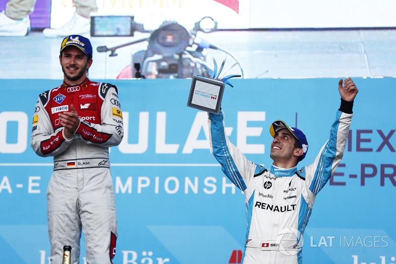 Daniel Abt, Audi Sport ABT Schaeffler, celebrates with Sébastien Buemi, Renault e.Dams, on the podim