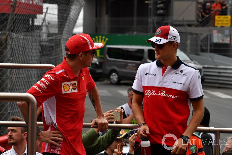 Kimi Raikkonen, Ferrari and Marcus Ericsson, Sauber on the drivers parade