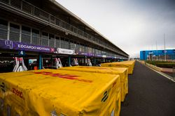 DHL crates in the pit lane