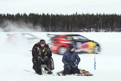 Picture shows fishermen on a frozen lake during the Rallycross on Ice project
