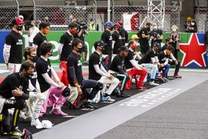 Drivers including Lewis Hamilton, Mercedes-AMG F1 taking the knee