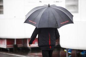 Honda Racing team member with a umbrella