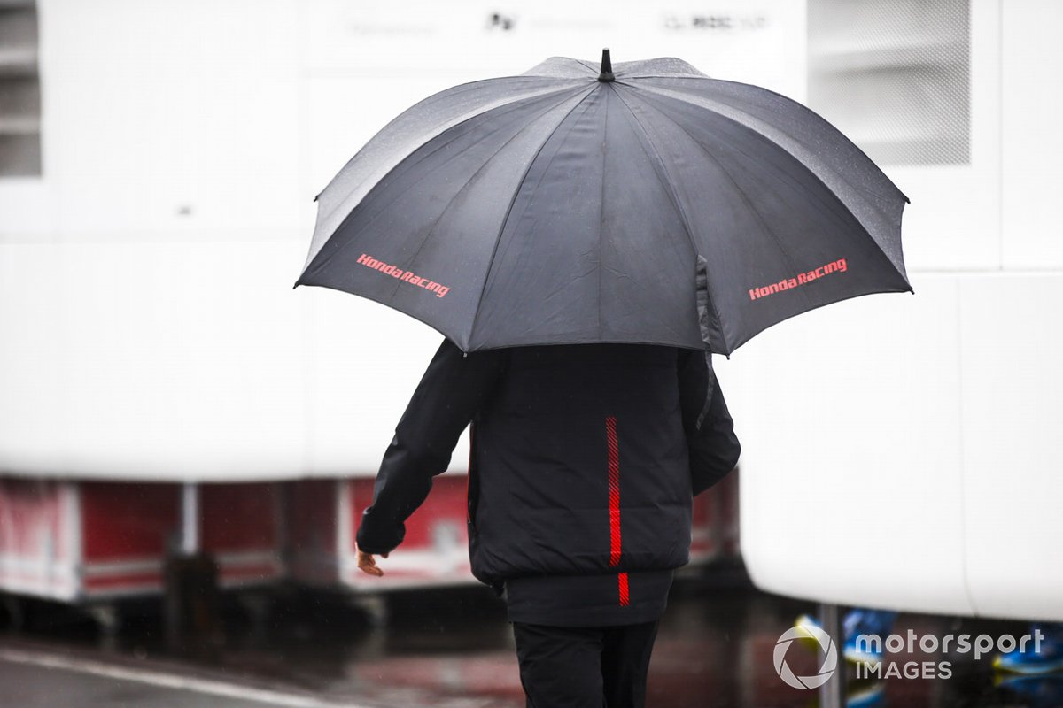 Honda Racing team member with a umbrella