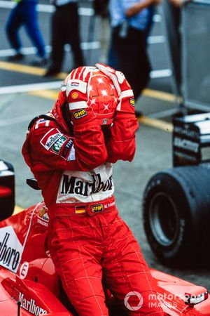 Michael Schumacher, 1st position, celebrates having secured his third F1 world title by winning the race