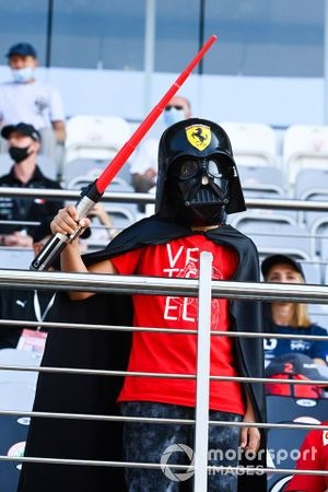A young fan in a grandstand dressed as Darth Vader