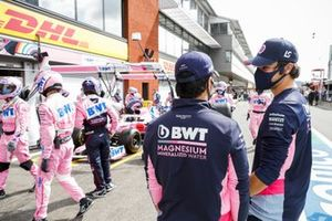 Sergio Perez, Racing Point, and Lance Stroll, Racing Point, watch the Racing Point pit crew as they practice their pit stop drills