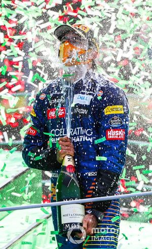 Carlos Sainz Jr., McLaren, 2nd position, sprays Champagne on the podium