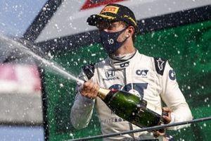 Carlos Sainz Jr., McLaren, 2nd position, and Pierre Gasly, AlphaTauri, 1st position, spray Champagne on the podium