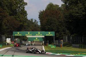 Romain Grosjean, Haas VF-20, Sebastian Vettel, Ferrari SF1000, and George Russell, Williams FW43