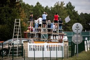 Fans watch the track action over the fence