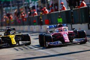Sergio Perez, Racing Point RP20, Daniel Ricciardo, Renault F1 Team R.S.20, in the pit lane