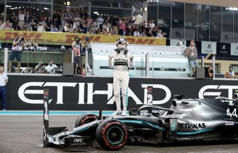 Lewis Hamilton, Mercedes AMG F1, celebrates on the grid after securing pole position