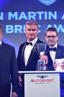 Presenter David Coulthard on stage to present the Aston Martin Autosport BRDC Young Driver Award