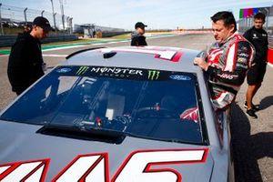 Tony Stewart climbs into a NASCAR