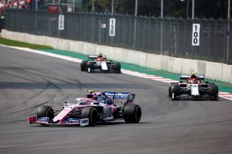 Lance Stroll, Racing Point RP19, leads Antonio Giovinazzi, Alfa Romeo Racing C38, and Kimi Raikkonen, Alfa Romeo Racing C38