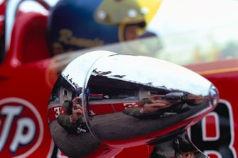Rainer Schlegelmilch reflected in the rear mirror of Ronnie Peterson, March 711 Ford