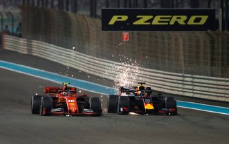 Max Verstappen, Red Bull Racing RB15, battles with Charles Leclerc, Ferrari SF90