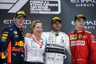 Max Verstappen, Red Bull Racing, 2nd position, the Mercedes trophy delegate, Lewis Hamilton, Mercedes AMG F1, 1st position, and Charles Leclerc, Ferrari, 3rd position, on the podium