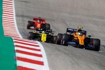 Lando Norris, McLaren MCL34, leads Daniel Ricciardo, Renault F1 Team R.S.19, and Sebastian Vettel, Ferrari SF90