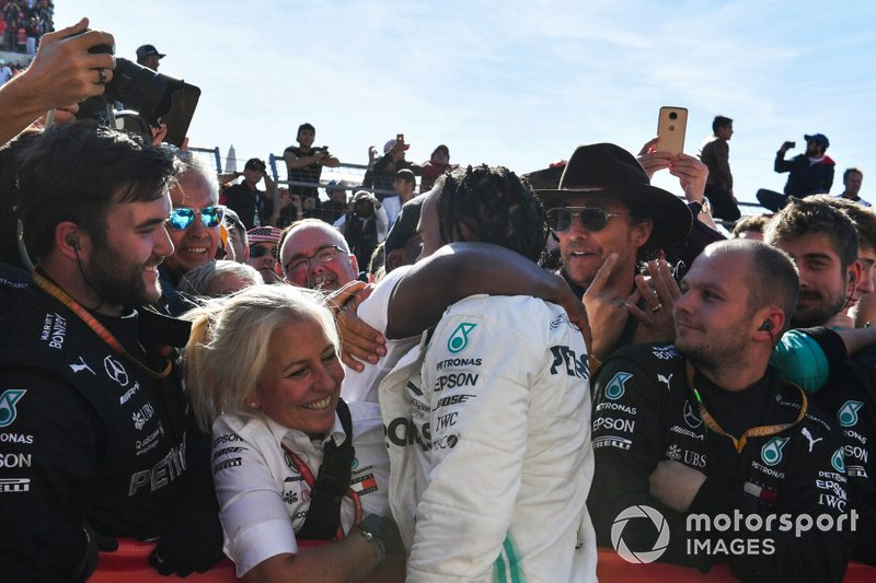 Lewis Hamilton, Mercedes AMG F1, 2nd position, celebrates in Parc Ferme with his father Anthony Hamilton and his team after securing the world drivers championship title for a sixth time
