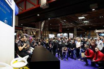 Tom Ingram is interviewed on the BTCC stand