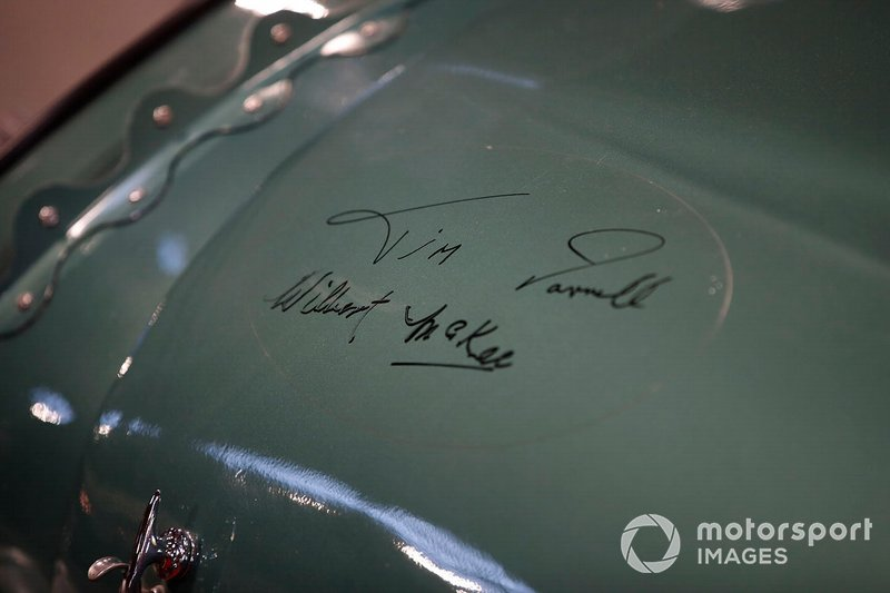 Signatures on a vintage Aston Martin race car