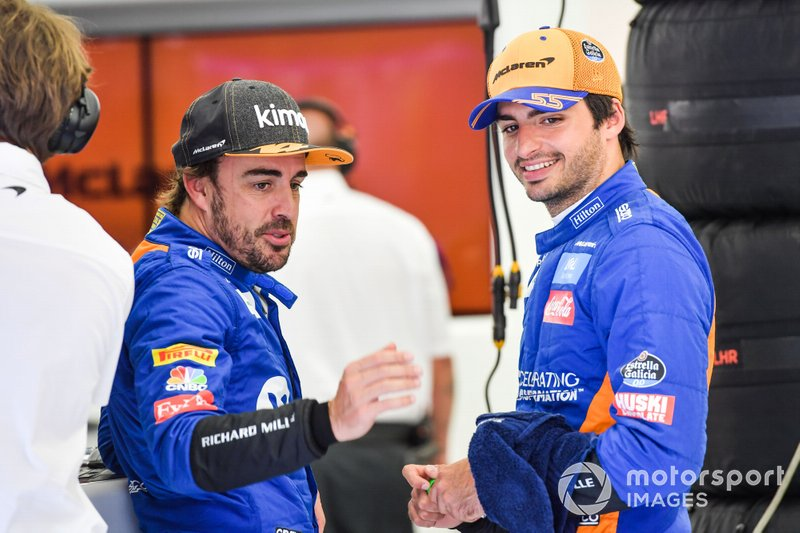 Fernando Alonso, McLaren, talks to Carlos Sainz Jr., McLaren