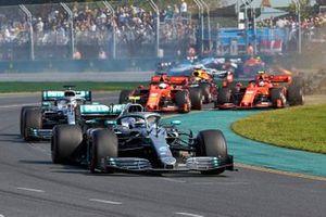 Valtteri Bottas, Mercedes AMG W10, leads Lewis Hamilton, Mercedes AMG F1 W10, Sebastian Vettel, Ferrari SF90, Charles Leclerc, Ferrari SF90, Max Verstappen, Red Bull Racing RB15, and the rest of the field at the start
