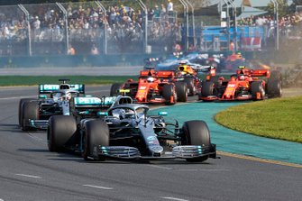 Valtteri Bottas, Mercedes AMG W10, leads Lewis Hamilton, Mercedes AMG F1 W10, Sebastian Vettel, Ferrari SF90, Charles Leclerc, Ferrari SF90, Max Verstappen, Red Bull Racing RB15, and the rest of the field at the start