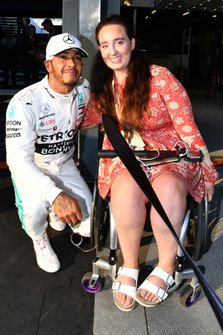 Lewis Hamilton, Mercedes AMG F1, with a guest