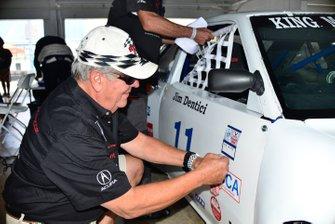 Jim Dentici applies the original 1988 SCCA Runoffs tech-inspection sticker to the restored 1988 Acura Integra.