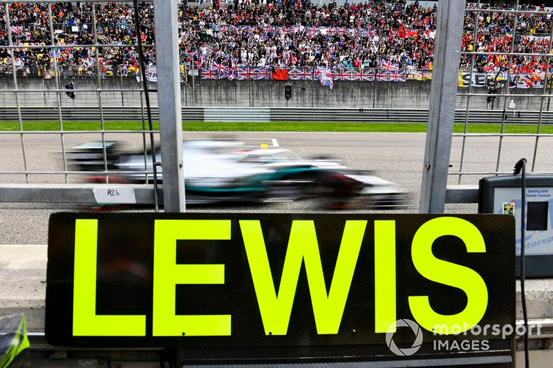 Lewis Hamilton, Mercedes AMG F1 W10, passes his pit board