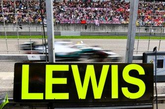 Lewis Hamilton, Mercedes AMG F1 W10, passes his pit board