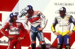 Podium: winner Mick Doohan, second place Loris Capirossi, third place Alex Barros