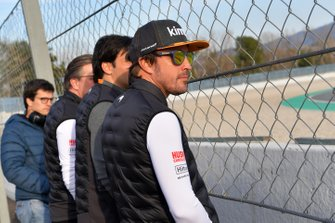 Fernando Alonso watches the action trackside