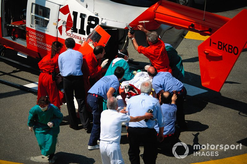 Roland Ratzenberger is stretchered into a medical helicopter after his fatal accident