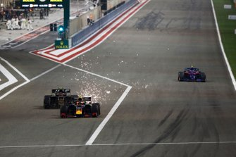 Pierre Gasly, Red Bull Racing RB15, leads Kevin Magnussen, Haas F1 Team VF-19, as he emerges from the pits, ahead of Alexander Albon, Toro Rosso STR14