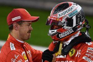 Sebastian Vettel, Ferrari, congratulates Charles Leclerc, Ferrari, on his first pole position in F1