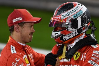 Sebastian Vettel, Ferrari, congratulates Charles Leclerc, Ferrari, on his first pole position in F1