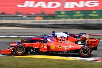 Sebastian Vettel, Ferrari SF90, passes Daniil Kvyat, Toro Rosso STR14