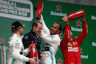 Valtteri Bottas, Mercedes AMG F1, 2nd position, Sebastian Vettel, Ferrari, 3rd position, and Lewis Hamilton, Mercedes AMG F1, 1st position, spray Champagne on the podium