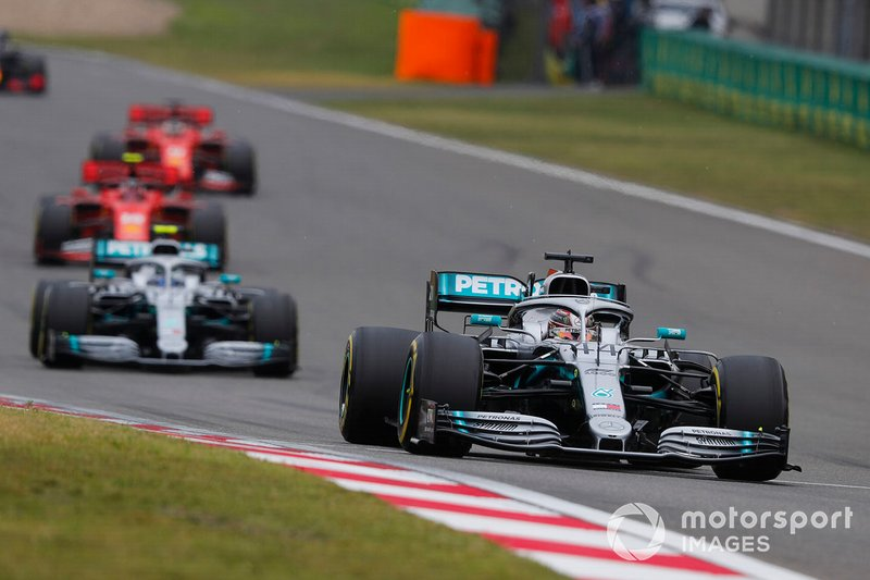 Lewis Hamilton, Mercedes AMG F1 W10, leads Valtteri Bottas, Mercedes AMG W10, and Charles Leclerc, Ferrari SF90