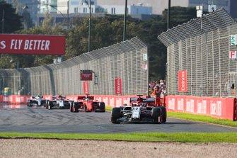 Kimi Raikkonen, Alfa Romeo Racing C38, leads Sebastian Vettel, Ferrari SF90, and Antonio Giovinazzi, Alfa Romeo Racing C38