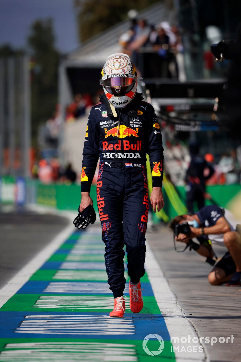 A dejected Max Verstappen, Red Bull Racing, walks back to the pits after crashing out with Lewis Hamilton, Mercedes