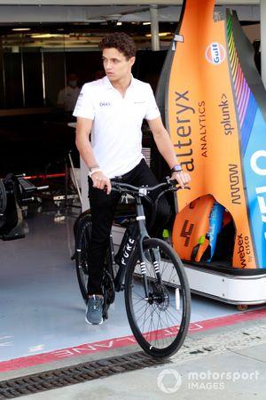 Lando Norris, McLaren MCL35M on bicycle