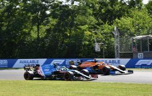 Esteban Ocon, Alpine A521, battles with Daniel Ricciardo, McLaren MCL35M