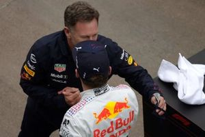 Christian Horner, Team Principal, Red Bull Racing, and Max Verstappen, Red Bull Racing, 2nd position, celebrate in Parc Ferme