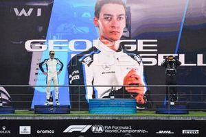 George Russell, Williams, 2nd position, and Lewis Hamilton, Mercedes, 3rd position, on the podium