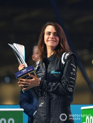 Model, Actress Cara Delevingne presents the winners trophy