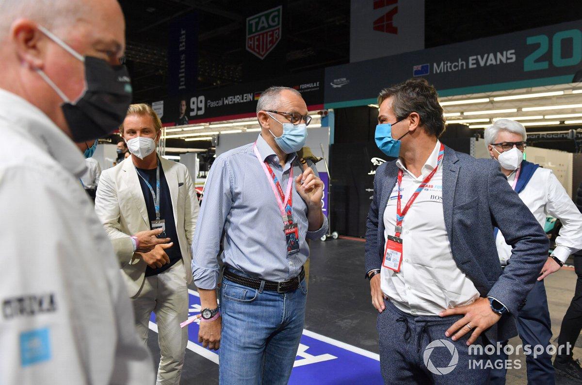 Nico Rosberg, Stefano Domenicali, CEO, Formula 1, Jamie Reigle, CEO of Formula E, in the pit lane